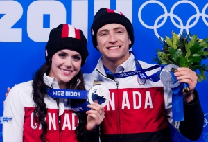 Canada's Tessa Virtue, left, and Scott Moir pose for a photograph after receiving their silver medals for ice dancing at the medal ceremonies during the 2014 Sochi Winter Olympics in Sochi, Russia on February 18, 2014. (Nathan Denette / The Canadian Press)