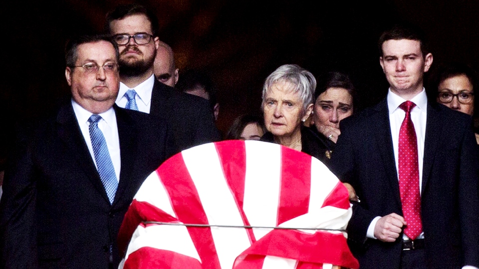 Widow Maureen McCarthy Scalia, center, and other family members, walk behind the casket as it is ushered out of the Bascilica following the funeral mass for the late Supreme Court Associate Justice Antonin Scalia, at the Basilica of the National Shrine of the Immaculate Conception in Washington, Saturday, Feb. 20, 2016 (AP / Pablo Martinez Monsivais).