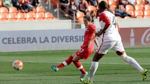 Canada's Jessie Fleming (17) shots to score a goal as Trinidad & Tobago's Karyn Forbes (14) defends during the second half of a CONCACAF Olympic qualifying tournament soccer match Sunday, Feb. 14, 2016, in Houston. Canada won 6-0. (AP Photo / David J. Phillip)