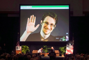 Edward Snowden appears on a live video feed broadcast from Moscow at an event sponsored by ACLU Hawaii in Honolulu on Feb. 14, 2015. (Marco Garcia/THE CANADIAN PRESS/AP)
