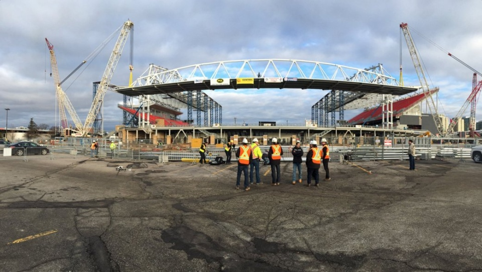 Construction crews are seen at BMO Field as a roof is installed over the south concourse of the stadium. (Toronto FC / Twitter)