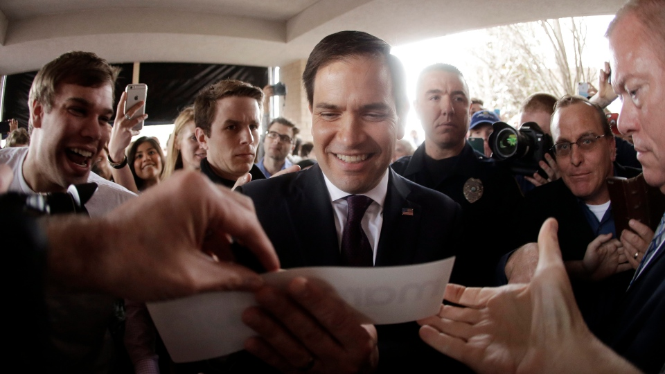 Republican presidential candidate Sen. Marco Rubio, R-Fla, autographs a bumper sticker after speaking at a rally Sunday, Feb. 21, 2016, in Franklin, Tenn. (AP Photo / Mark Humphrey)