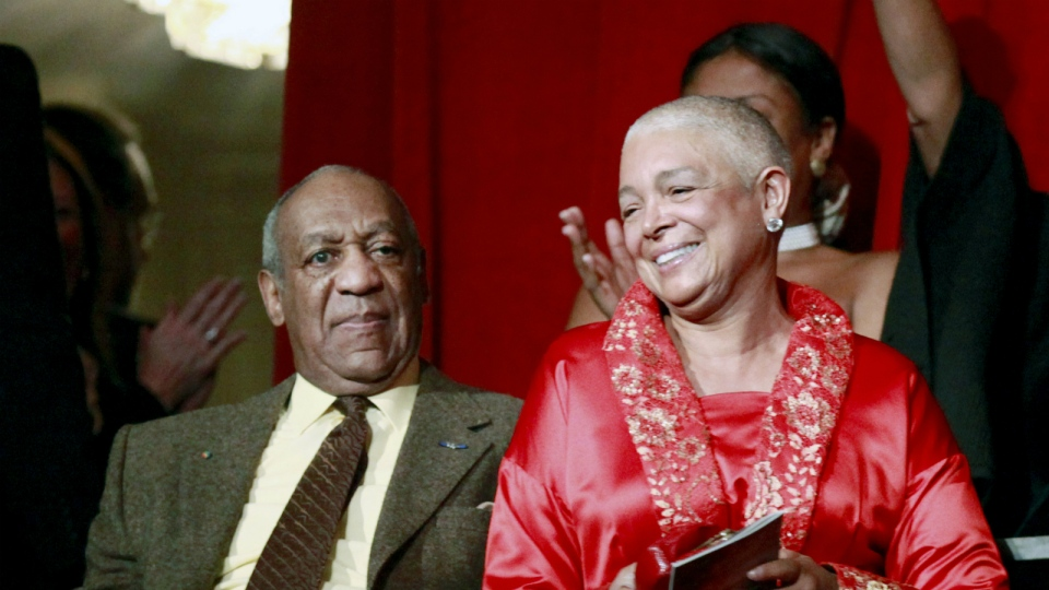 Comedian Bill Cosby, left, and his wife Camille appear at the John F. Kennedy Center for Performing Arts before Bill Cosby received the Mark Twain Prize for American Humor in Washington on Oct. 26, 2009. (AP / Jacquelyn Martin)