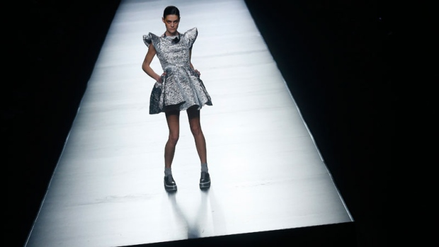 A model displays a design by Maya Hansen