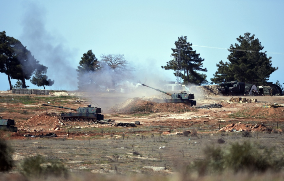 In this Feb. 16, 2016, file photo, Turkish artillery fire from the border near Kilis town toward northern Syria, in Kilis, Turkey. (AP Photo/Halit Onur Sandal, File)
