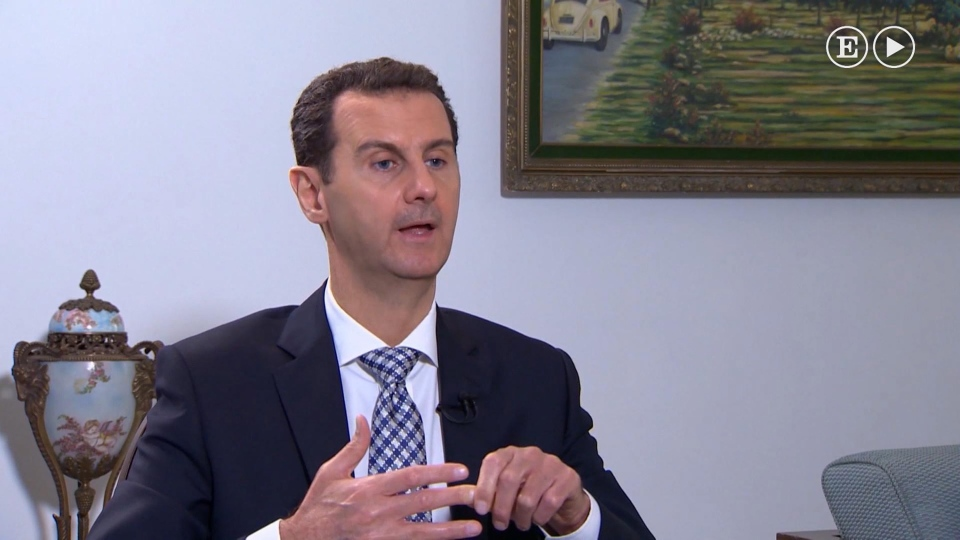 In this undated image made from video, Syrian President Bashar Assad, is interviewed in Damascus, Syria, by a journalist with Spanish El Pais newspaper published Sunday Feb. 21, 2016. (Syrian Presidency / El Pais video via AP)