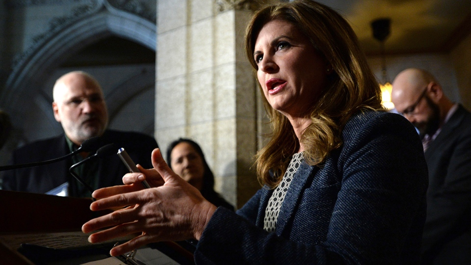 Interim Conservative leader Rona Ambrose speaks to reporters in the foyer of the House of Commons on Parliament Hill in Ottawa on Monday, Feb. 22, 2016. (Sean Kilpatrick / THE CANADIAN PRESS)