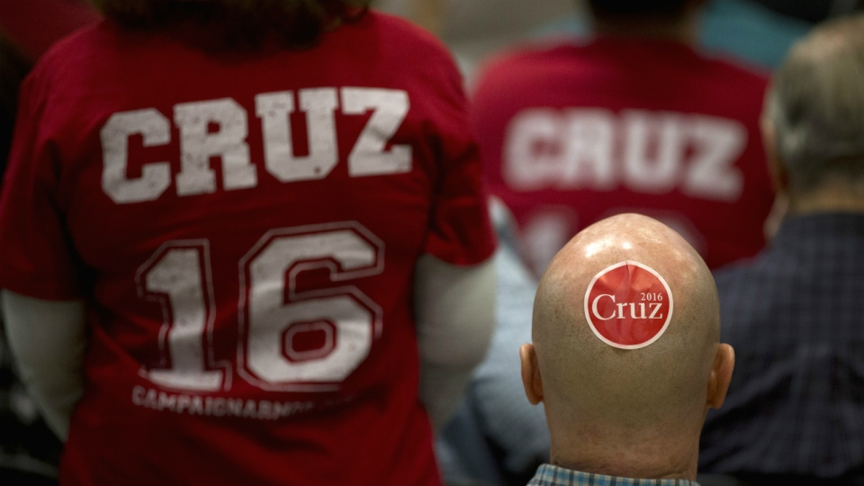 Karl Ennenga listens to a song with a campaign sticker on the back of his head while waiting for the arrival of Republican presidential candidate, Sen. Ted Cruz, R-Texas, at Durango Hills Community Center in Las Vegas on Monday, Feb. 22, 2016. (AP / Jae C. Hong)
