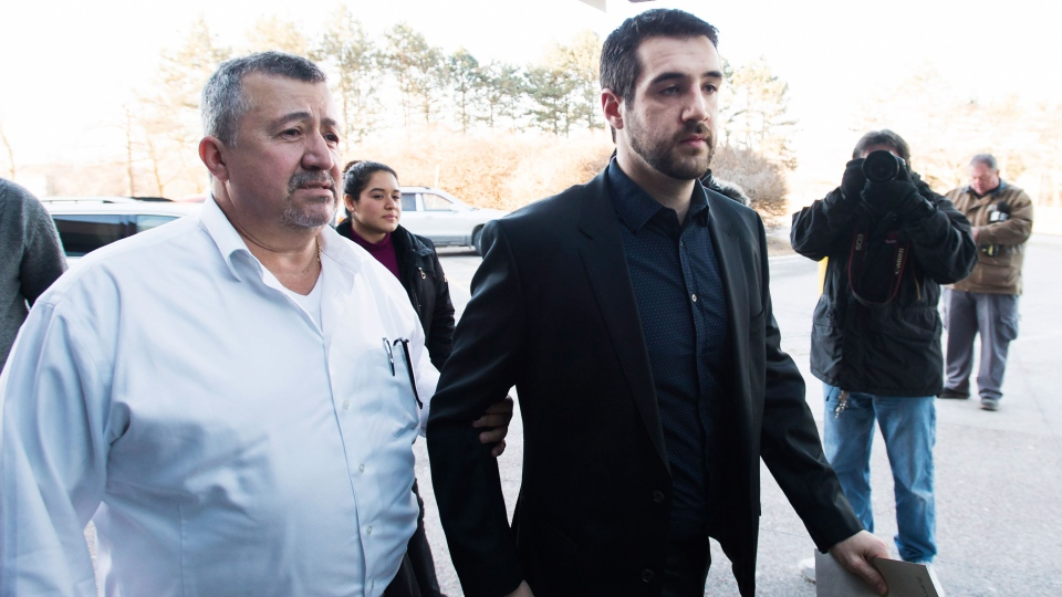 Marco Muzzo, right, arrives with family at the court house for his sentencing hearing in Newmarket, Ont., on Tuesday, Feb. 23, 2016. (Nathan Denette / THE CANADIAN PRESS)