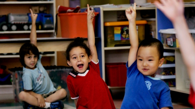 Children put up their hands for ice cream at a daycare centre in Montreal on Friday, August 18, 2006. (Ian Barrett / THE CANADIAN PRESS)