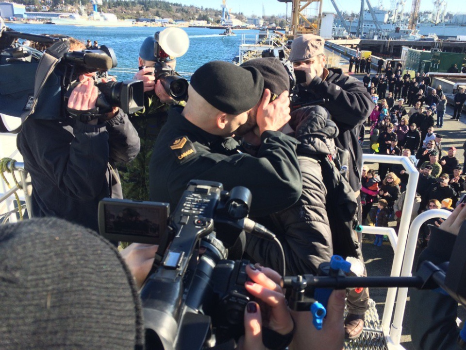 "Master Seaman Francis Legare shares the coveted ""first kiss"" with partner Corey after HMCS Winnipeg docked at CFB Esquimalt Tues., Feb. 23, 2016. (CTV Vancouver Island)"