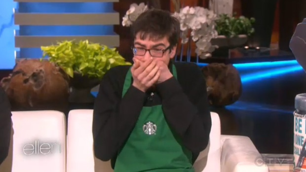 Sam Forbes reacts after learning Ellen DeGeneres is sending him on a trip to Japan. (The Ellen DeGeneres Show)