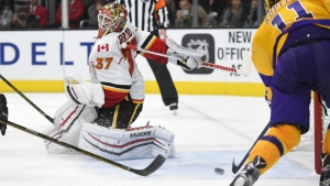 Los Angeles Kings centre Anze Kopitar, right, scores on Calgary Flames goalie Joni Ortio during the second period of an NHL hockey game in Los Angeles on Tuesday, Feb. 23, 2016. (AP / Mark J. Terrill)