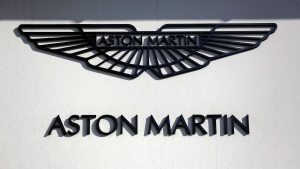 An Aston Martin sign is seen outside a dealership on Park Lane in London, Wednesday, Feb. 24, 2016. (AP / Matt Dunham)