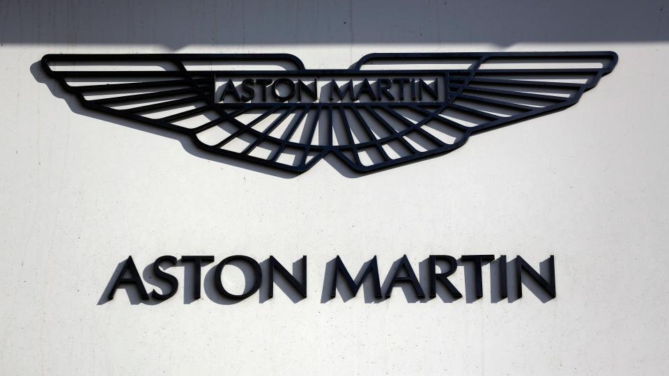 An Aston Martin sign is seen outside a dealership on Park Lane in London, Wednesday, Feb. 24, 2016. (AP / Matt Dunham)