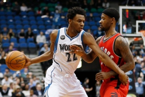 In this Wednesday, Feb. 10, 2016 file photo, Minnesota Timberwolves forward Andrew Wiggins (22) pushes the ball around Toronto Raptors guard Terrence Ross (31) in the first half of an NBA basketball game in Minneapolis. (Stacy Bengs / AP Photo)