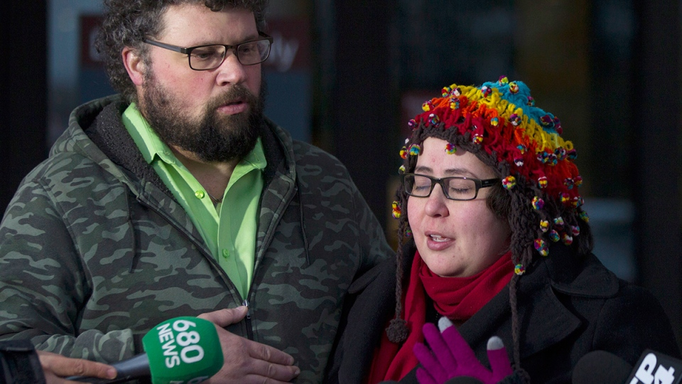 Jennifer Neville-Lake stands with her husband Edward as they talk to the media outside at the courthouse in Newmarket, Ont., on Wednesday, Feb. 24, 2016. (Chris Young / THE CANADIAN PRESS)
