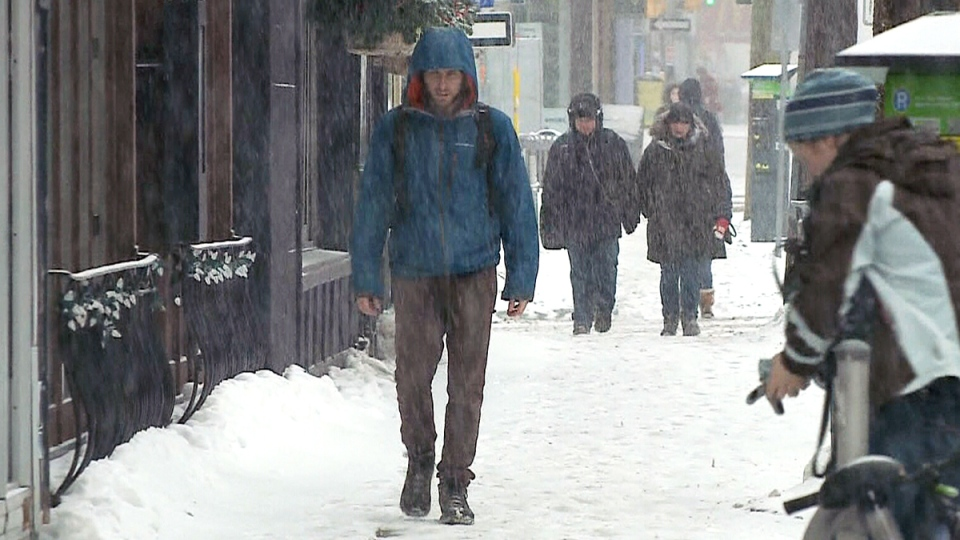 People walk the streets during a snow storm in Ottawa, Wednesday, Feb. 24, 2016.