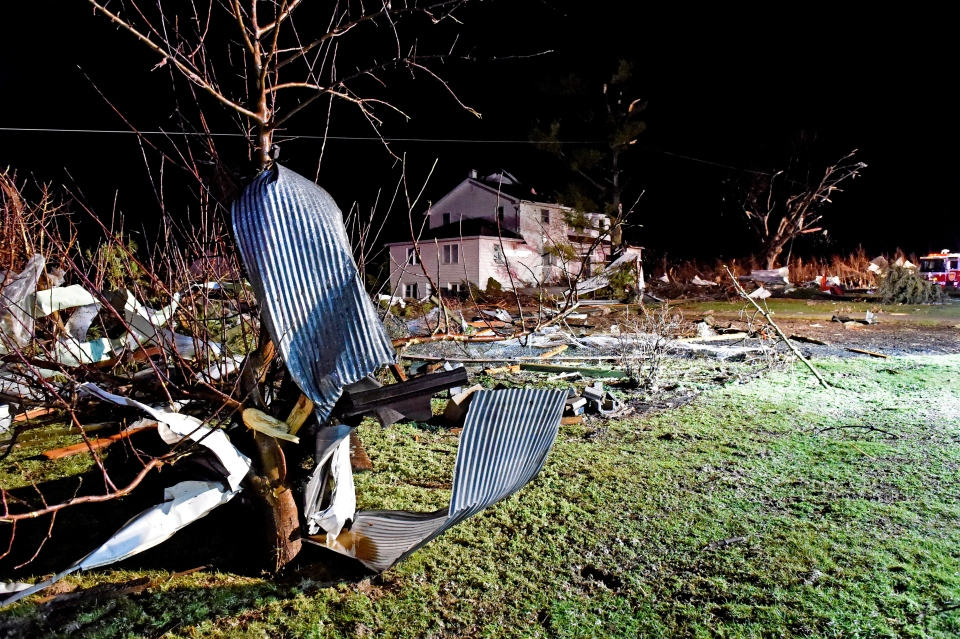 Debris from chicken houses that were levelled in a severe storm is strewn along Millwood Road in Gap Pa. Wednesday, Feb. 24, 2016. The roof was blown off the house in the background. (Blaine Shahan/LNP Media Group via AP)