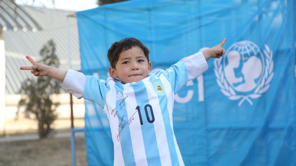 Murtaza Ahmadi, 5, of Afghanistan, shows off his signed jersey from soccer star Lionel Messi. (Twitter / UNICEF Afghanistan)