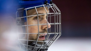 Vancouver Canucks' defenceman Dan Hamhuis, who was injured after being struck in the face by a puck during a game in December, wears a cage on his helmet during NHL hockey practice in Vancouver, B.C., on Monday, January 25, 2016. (THE CANADIAN PRESS/Darryl Dyck)
