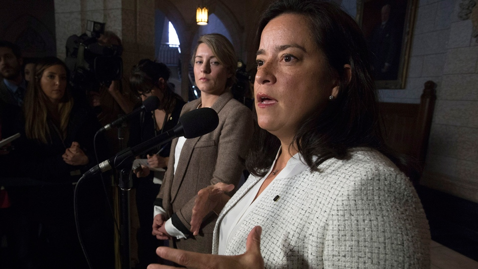 Heritage Minister Melanie Joly (left) looks on as Minister of Justice and Attorney General of Canada Jody Wilson-Raybould speaks with the media about the Special Joint Committee on Physician-Assisted Dying report tabled in Ottawa, Thursday, Feb. 25, 2016. (Adrian Wyld / THE CANADIAN PRESS)