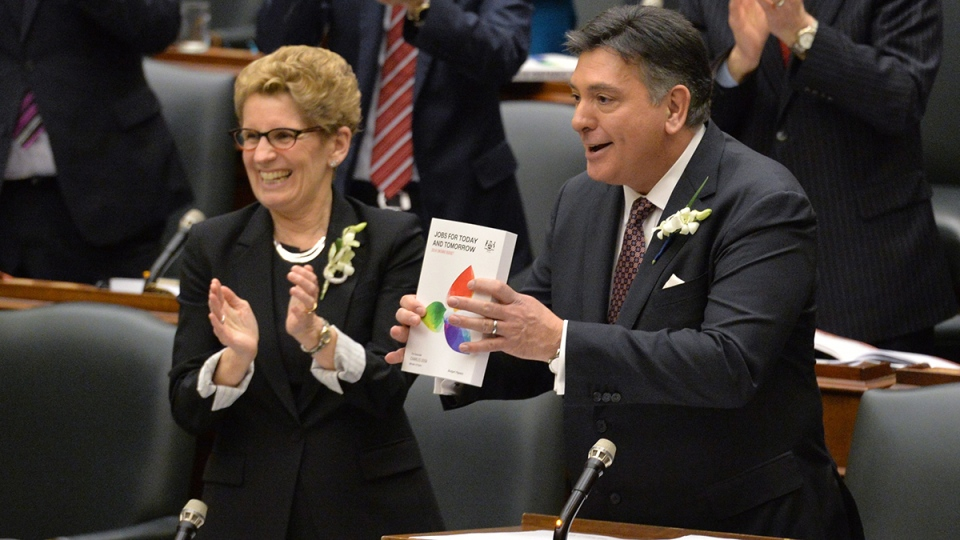 Ontario Finance Minister Charles Sousa, right, delivers the Ontario 2016 budget next to Premier Kathleen Wynne, left, at Queen's Park in Toronto on Thursday, Feb.  25, 2016. (Nathan Denette / THE CANADIAN PRESS)