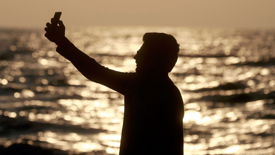 In this Feb. 22, 2016 photo, an Indian man takes a selfie in Mumbai's coastline. (AP/ Rafiq Maqbool)