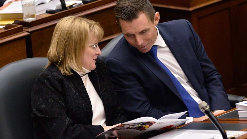 Ontario Progressive Conservative Leader Patrick Brown, right, talks with MPP Sylvia Jones as Ontario Finance Minister Charles Sousa delivers the Ontario 2016 budget at Queen's Park in Toronto on Thursday, Feb. 25, 2016. (Nathan Denette / THE CANADIAN PRESS)