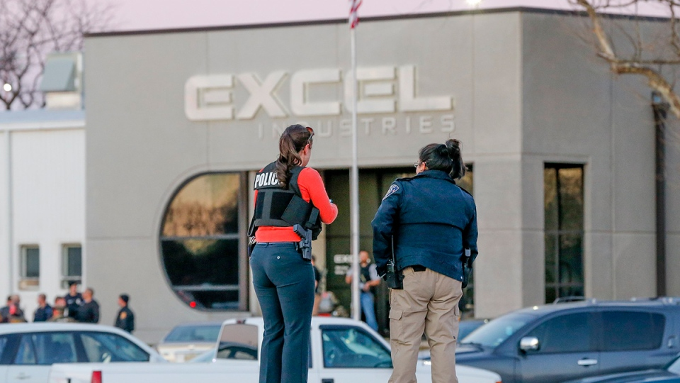 Police guard the front door of Excel Industries in Hesston, Kan., Thursday, Feb. 25, 2016, where a gunman killed an undetermined number of people and injured many more. (Fernando Salazar / The Wichita Eagle via AP)