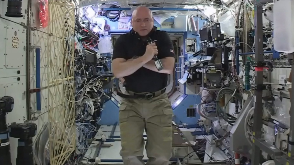 In this image from video made available by NASA, astronaut Scott Kelly speaks to reporters on Earth during a news conference held on the International Space Station on Thursday, Feb. 25, 2016. (NASA via AP)