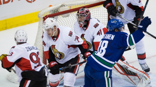 Jake Virtanen scores against the Senators