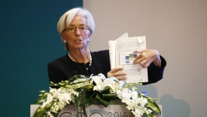 International Monetary Fund (IMF) Managing Director Christine Lagarde holds a document report while speaking during a session of the G20 High-Level Seminar on Structural Reform, proceeding the G20 Finance Ministers and Central Bank Governors Meeting at the Pudong Shangri-la Hotel in Shanghai, China, Friday, Feb. 26, 2016. (AP / Rolex Dela Pena)