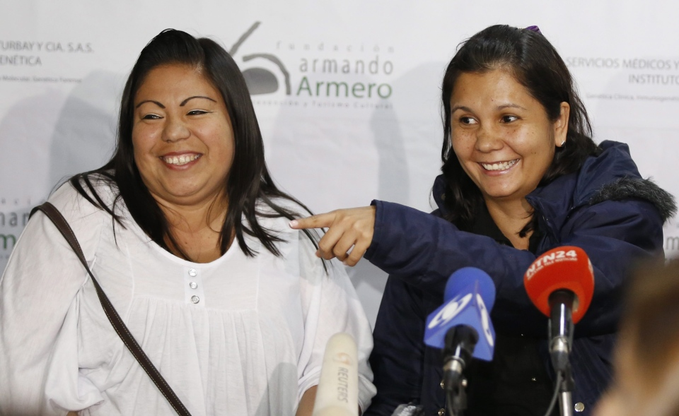 Jacqueline Vasquez Sanchez, left, and her sister Lorena Sanchez, right, smile during a press conference in Bogota, Colombia, Thursday, Feb. 25, 2016.  (AP Photo/Fernando Vergara)