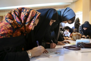 Iranian voters fill out their ballots during the parliamentary and Experts Assembly elections in a polling station in central Tehran, Iran, Friday, Feb. 26, 2016. (AP / Vahid Salemi)