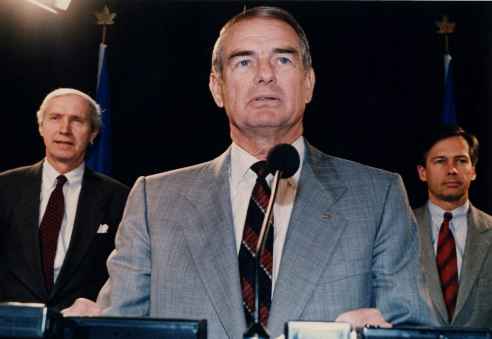 Alberta Premier Don Getty, Treasurer Dick Johnston, left, and Energy Minister Rick Orman, right, at a news conference at the Alberta Legislature in Edmonton, Alta., Feb. 21, 1990. (THE CANADIAN PRESS/Ray Giguere)