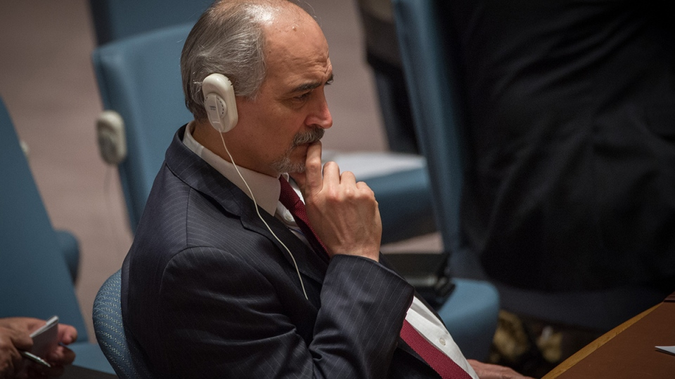 Syria's permanent representative to the United Nations Bashar Ja'afari listens before a Security Council vote to support a resolution endorsing a cease-fire in Syria, at United Nations headquarters, Friday, Feb. 26, 2016. (AP / Bryan R. Smith)
