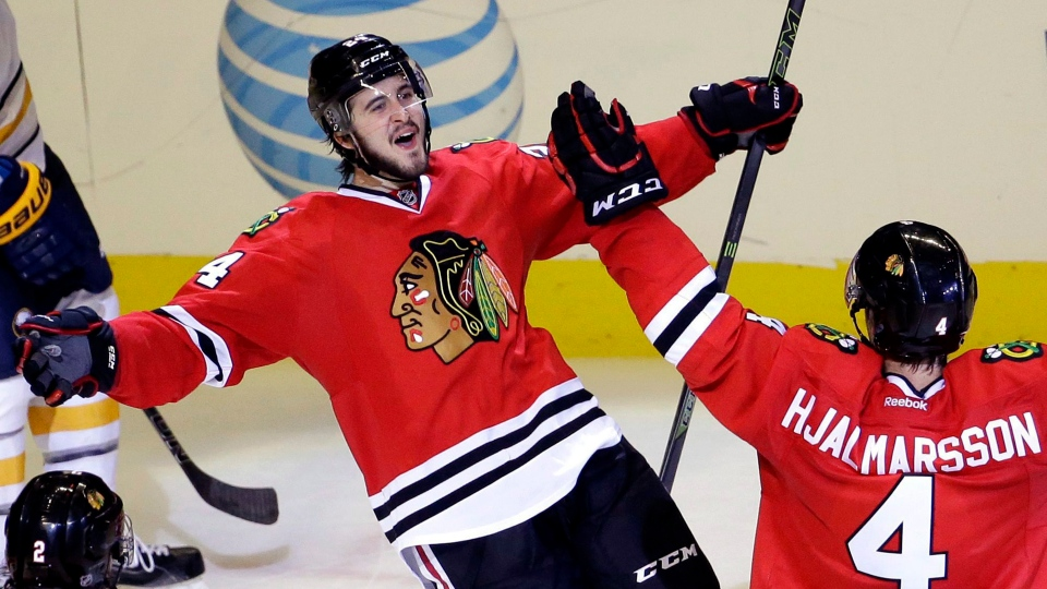 Chicago Blackhawks center Phillip Danault, top left, celebrates with defenceman Niklas Hjalmarsson after scoring a goal. The 23-year-old Quebec native is now a member of the Canadiens. (AP Photo/Nam Y. Huh)