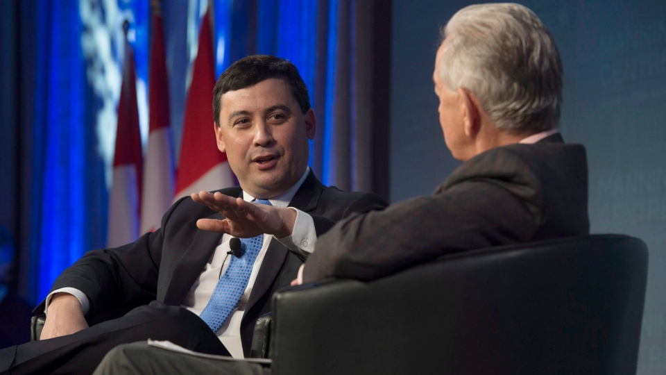 Michael Chong speaks with Preston Manning at a conservative conference, in Ottawa, on Friday, Feb. 26, 2016. (THE CANADIAN PRESS/Adrian Wyld)