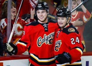 Calgary Flames' Sam Bennett, left, celebrates his goal with teammate Jiri Hudler, from the Czech Republic, during first period NHL hockey action against the Florida Panthers in Calgary on Jan. 13, 2016. (Jeff McIntosh / The Canadian Press)
