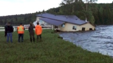 House sinking in flood
