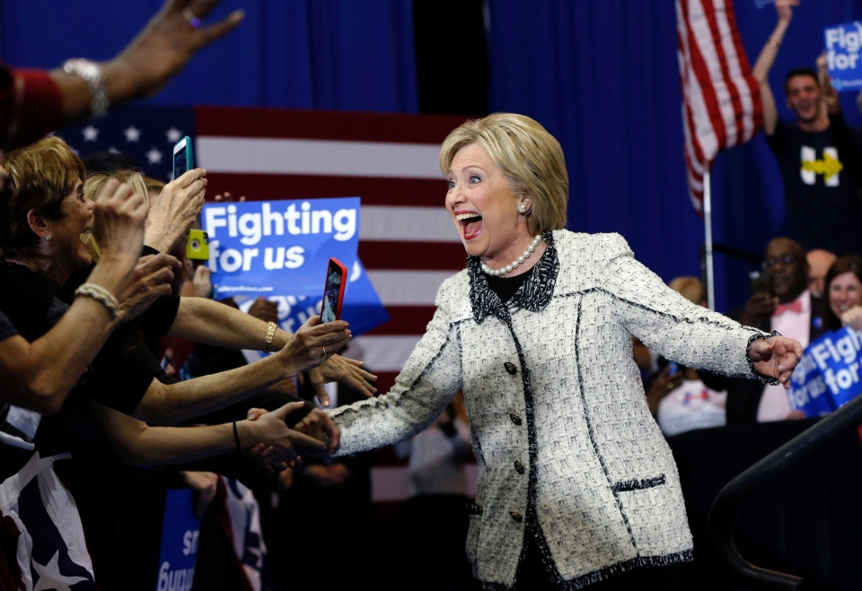 Democratic presidential candidate Hillary Clinton greets supporters as she arrives to speak to supporters at her election night watch party for the South Carolina Democratic primary in Columbia, S.C., Saturday, Feb. 27, 2016. (AP / Gerald Herbert)