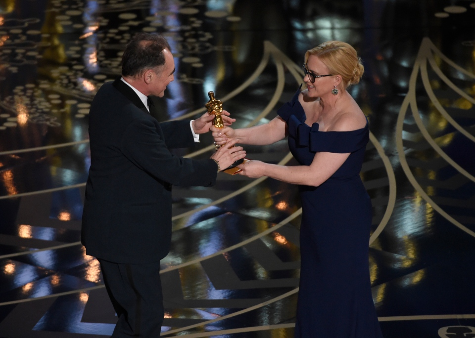 Patricia Arquette, right, presents Mark Rylance with the award for best actor in a supporting role for 'Bridge of Spies' at the Oscars on Sunday, Feb. 28, 2016, at the Dolby Theatre in Los Angeles. (Photo by Chris Pizzello/Invision/AP)