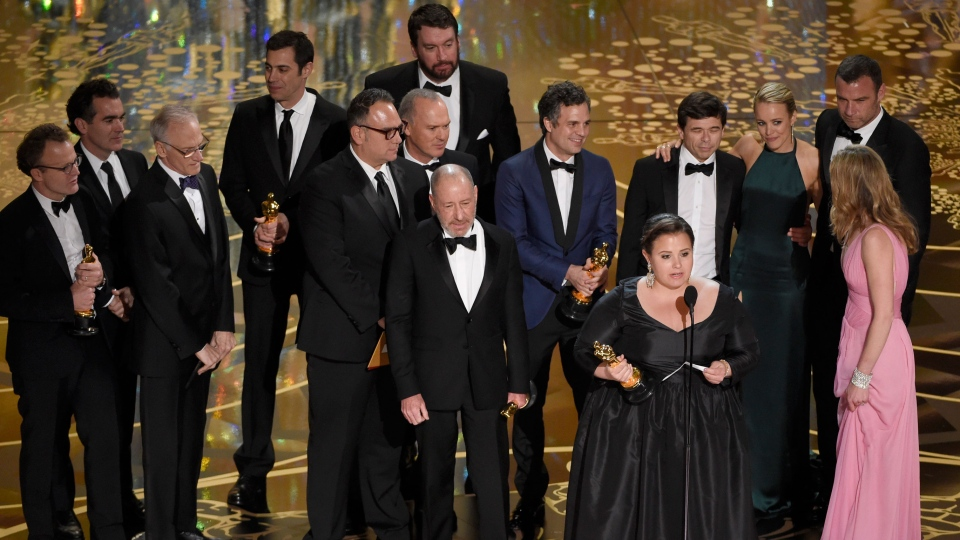Nicole Rocklin, pictured at front, and cast and crew of 'Spotlight' accept the award for best picture for 'Spotlight' at the Oscars on Sunday, Feb. 28, 2016, at the Dolby Theatre in Los Angeles. (Photo by Chris Pizzello/Invision/AP)