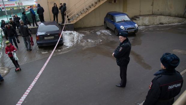 Russian police officers secure the area