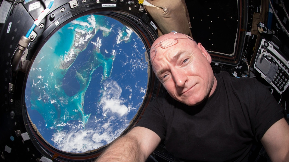 In this July 12, 2015 photo, Astronaut Scott Kelly takes a photo of himself inside the Cupola, a special module of the International Space Station which provides a 360-degree viewing of the Earth and the station. (Scott Kelly / NASA via AP)