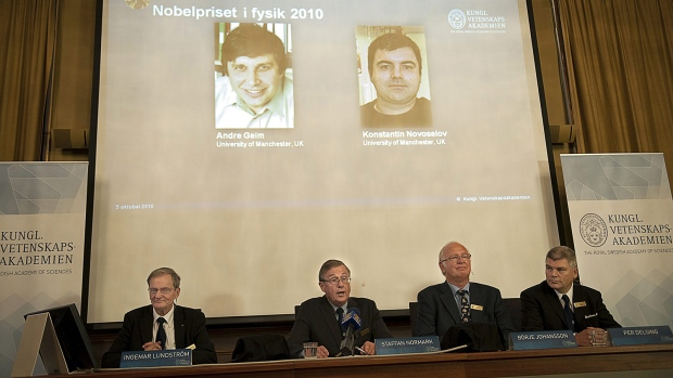 Russian-born scientists Andre Geim (L, on screen) and Konstantin Novoselov (R) won a Nobel Prize for their work with graphene. (AFP PHOTO / SCANPIX - MAJA SUSLIN)