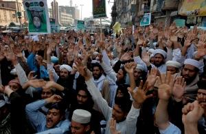 Pakistani supporters of Mumtaz Qadri protest his execution in Peshawar, Pakistan, Monday, Feb. 29, 2016. (AP/Mohammad Sajjad)