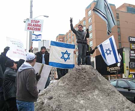Pro-Israel demonstrators protest across the street from anti-Israel protesters who came out in Toronto on Sunday, Dec. 28, 2008 to denounce the Israeli military action in the Gaza Strip and show solidarity with the Palestinian people. (THE CANADIAN PRESS/Colin Perkel)