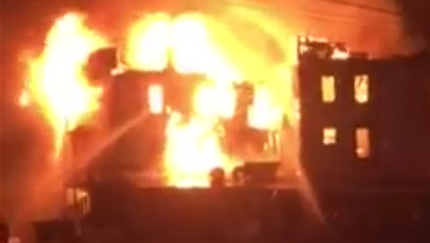 A still taken from video submitted by Aaron Watson shows flames engulfing the Mirror Hotel Sunday, February 28.